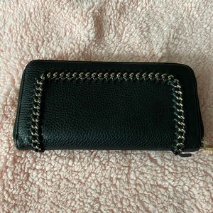 Black wallet with gold detail